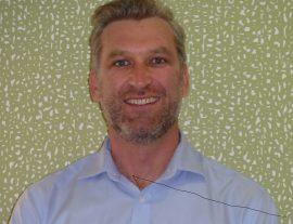 Dr Christian Behan